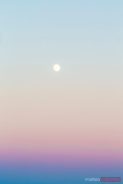 Moon in the sky at sunset, Greece