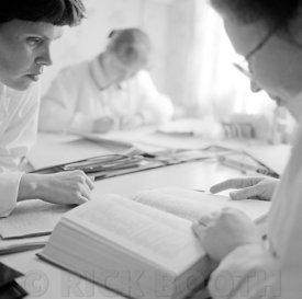 Nurses consult a textbook at a hospital in Lovozero, Russia.