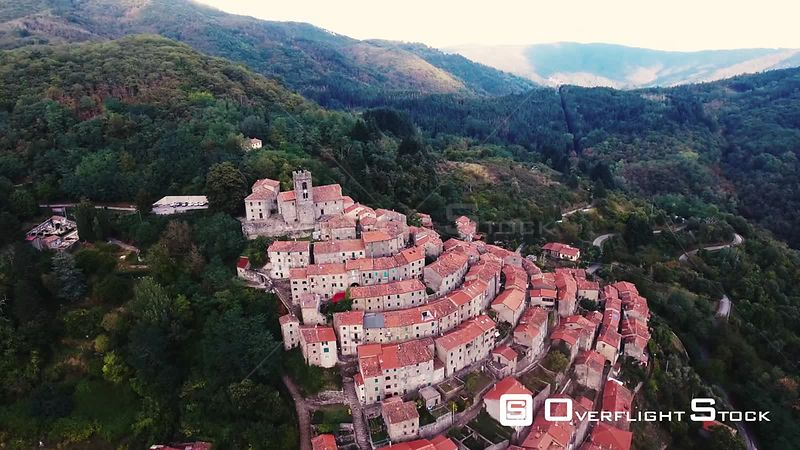 Aerial shot of a small town on the hill in Tuscany, Italy, 4K