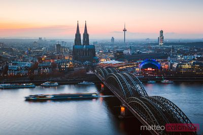 Bridge and city skyline at dusk, Cologne, Germany