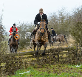 Ashley Bealby jumping the hunt jump at Newbold - The Fitzwilliam Hunt visit the Cottesmore at Burrough House