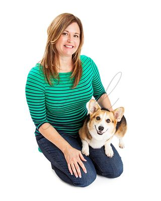 Woman Sitting With Welsh Corgi Dog