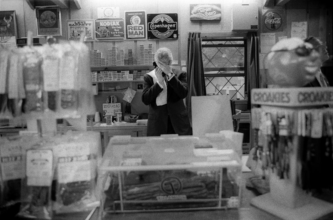 President William Clinton discuses middle-east peace while on a secure phone line at a convince store in Arkansas.