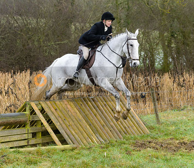 Margo Sly jumping a hunt jump at Peakes - The Fitzwilliam Hunt visit the Cottesmore at Burrough House