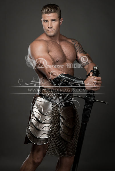 Bare Chested Light Haired Man with Sword