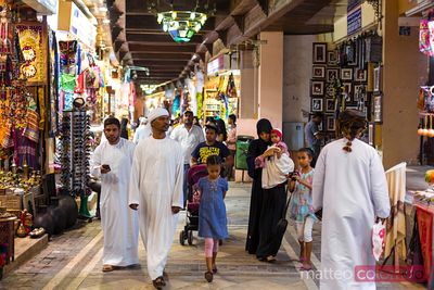 Oman, Muscat. Local people walking in the old Mutrah souk