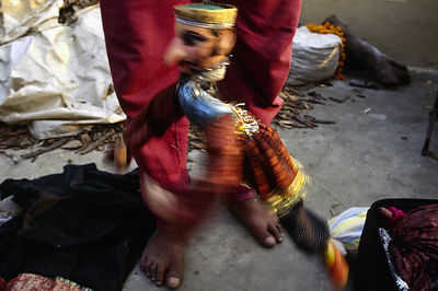 India - New Delhi - A puppeteer makes his puppet dance