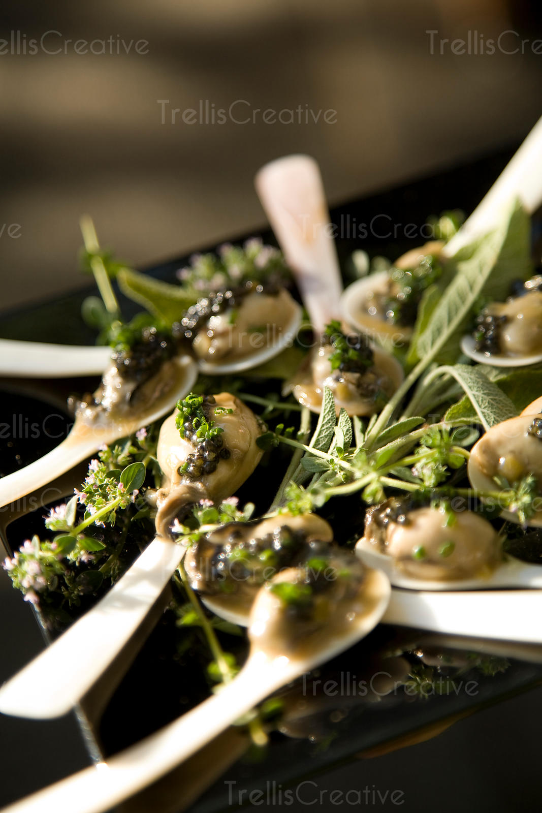 A plate of oyster and caviar hors d'oeuvres