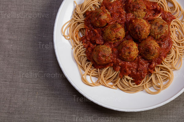 Close-up of meatballs with pasta and tomato marinara served in white plate