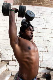 Weightlifter on the ghats along the Ganges River, Varanasi, India.
