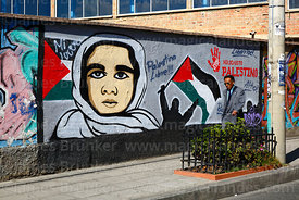 Man walking past a mural showing support for Palestine, La Paz, Bolivia