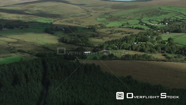 Aerial view tracking over Postbridge, Dartmoor National Park, Devon, England, UK, October 2015.