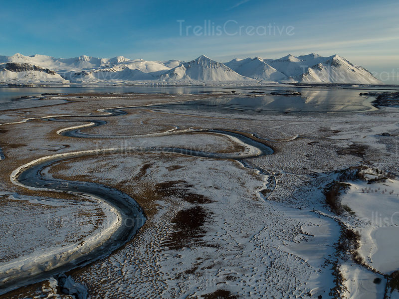 Aerial view of the snow covered mountains along the fjord in Borganes, Iceland