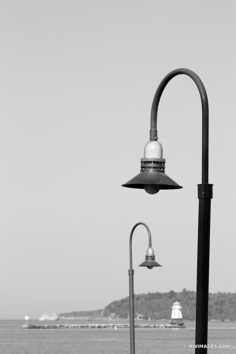 BURLINGTON VERMONT STREET LAMPS BREAKWATER LIGHTHOUSE BURLINGTON VERMONT HARBOR BLACK AND WHITE VERTICAL