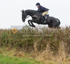 Emilie Chandler jumping a hedge near Clawson Thorns - Belvoir Hunt Opening Meet 2016