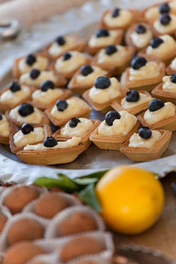 Goat cheese and lemon custard tartlets with blueberries