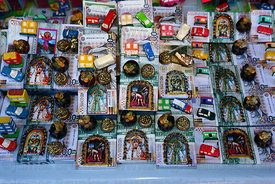 Miniature money bundles and religious icons for sale in market for Alasitas festival, Puno, Peru