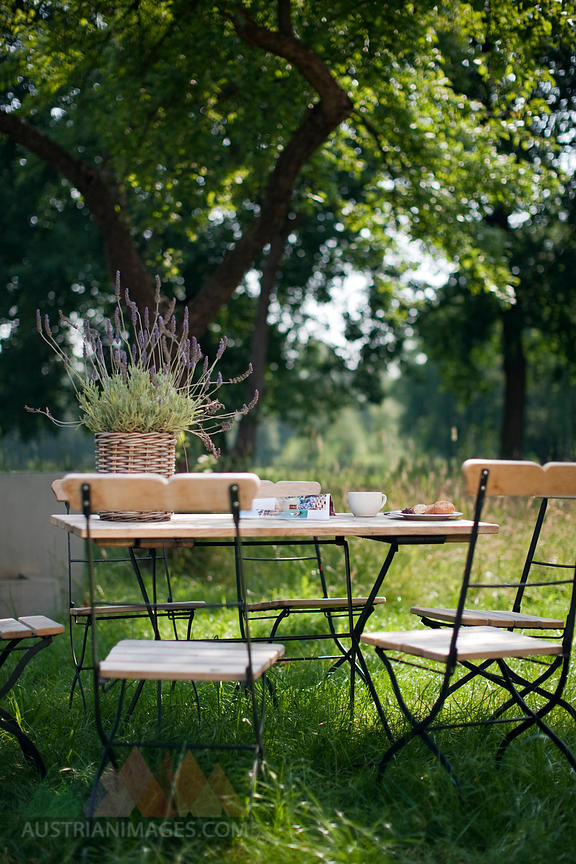 Germany, Hamburg, Empty chairs and table in garden