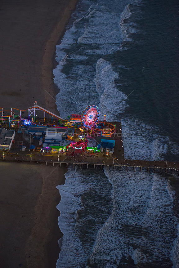 Aerial view of Santa Monica Pier and Pacific Ocean at night, Los Angeles, CA, USA