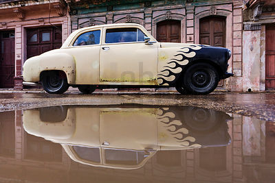 Vintage Car Reflected in Puddle