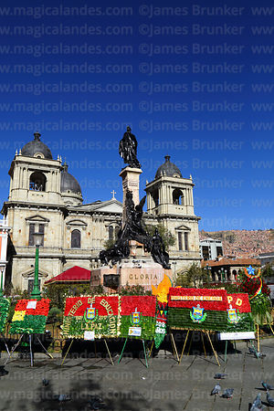 Floral tributes in colours of La Paz flag for 16th July uprising anniversary celebrations at base of the Murillo Monument, Plaza Murillo, La Paz, Bolivia