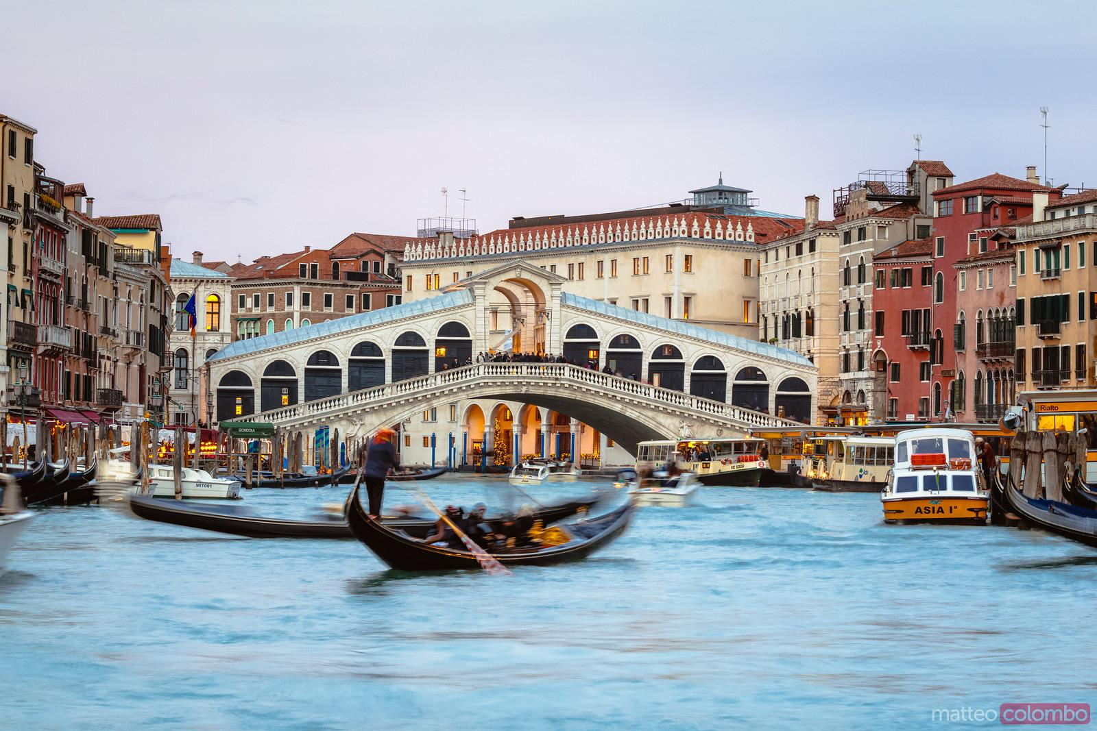 Rialto bridge and gondola at sunset, Venice, Italy