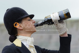 Amy Jane Bryan enjoying some Dutch Courage - Dianas of the Chase - Side Saddle Race 2014.