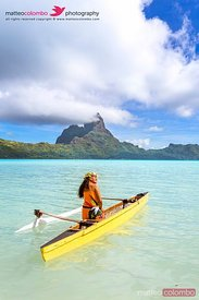 Local woman on outrigger canoe, Bora Bora, French Polynesia
