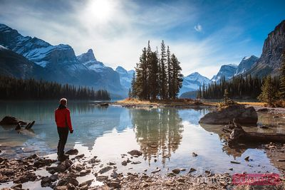 Man looking at Spirit Island, Maligne lake, Canada