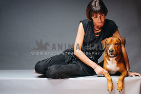 Studio portrait of woman with dog