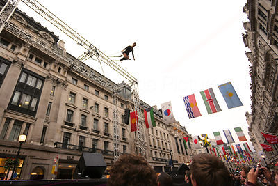 .Swinging Trapeze Artist Swinging high above Regent Street