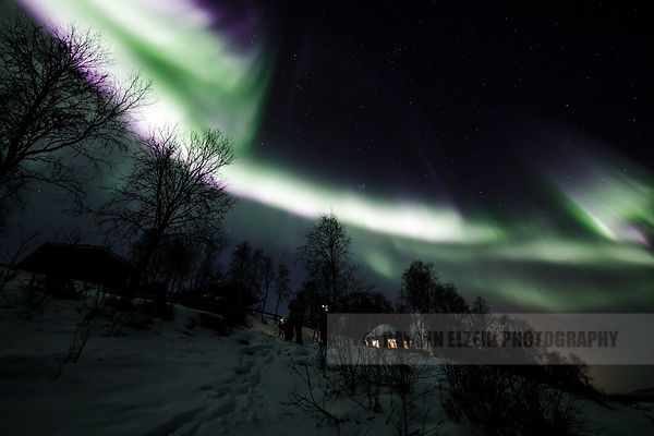 Photographers shooting the aurora in Utsjoki, Finnish Lapland