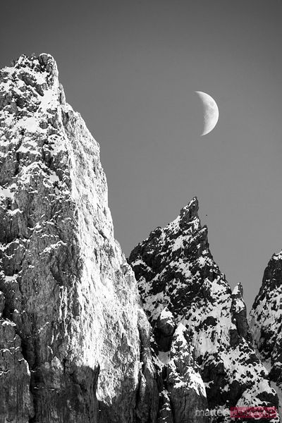 Mountain peaks and moon at day time Dolomites Italy