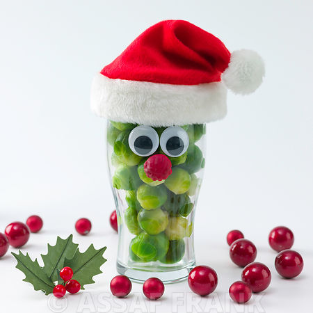 Santa face on glass filled with brussel sprouts