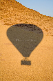 The shadow of a hot air balloon during a flight over the Sossuvlei sand dunes, Namibia