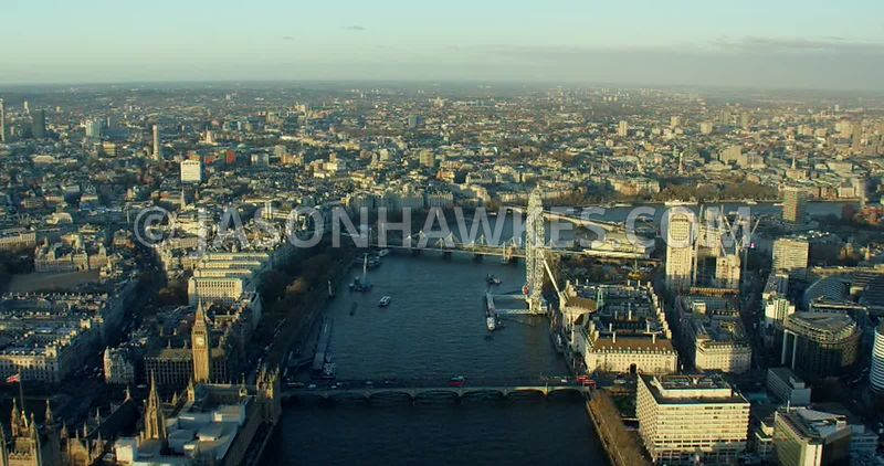 Aerial footage of the River Thames as it flows between Lambeth and Westminster