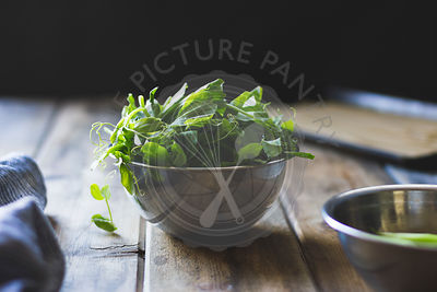 Pea shoots in a metallic bowl