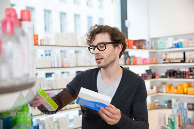 Man comparing products in a pharmacy