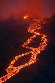 Aerial view of lava river originating from Kilauea Volcano, erupting as fountains from fissure 8, Leilani Estates subdivision...