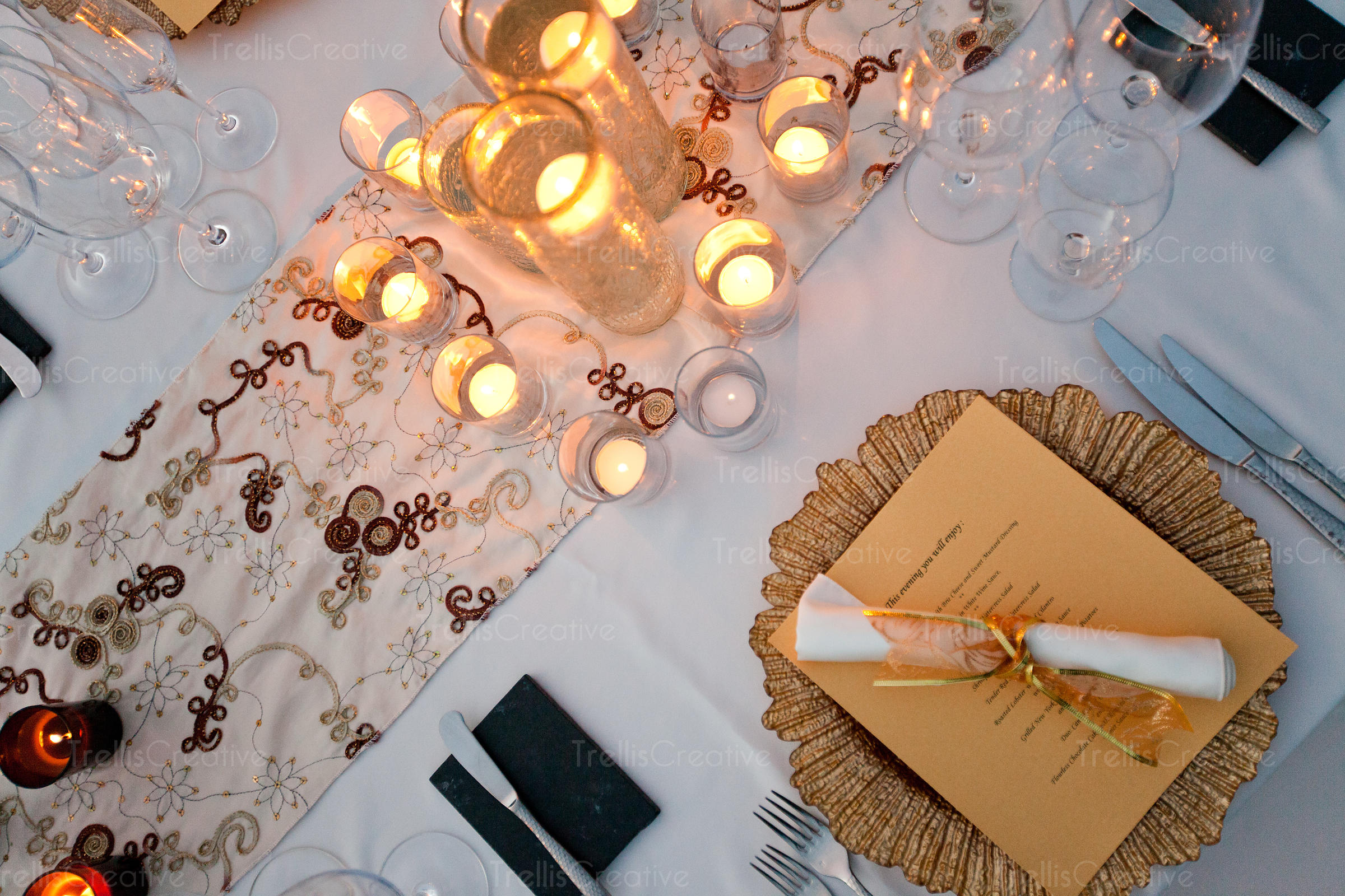 An elegant candle light placesetting at a party