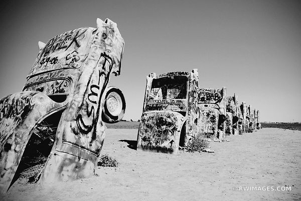 SPRAY PAINTED CADILLACS CADILLAC RANCH AMARILLO TEXAS ROUTE 66 BLACK AND WHITE