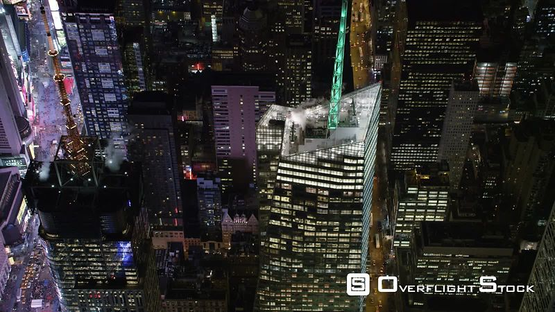 Flying Over Buildings of Midtown Manhattan Near Times Square at Night.