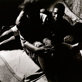 'Foday', a former child combatant with a prostitute in a brothel where he is the enforcer. The girl was abducted from her vil...
