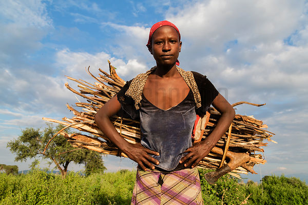 Portrait of a Woman Carrying Firewood