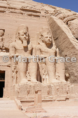 Two colossi of Ramesses II on the facade of the Sun Temple of Abu Simbel, Egypt