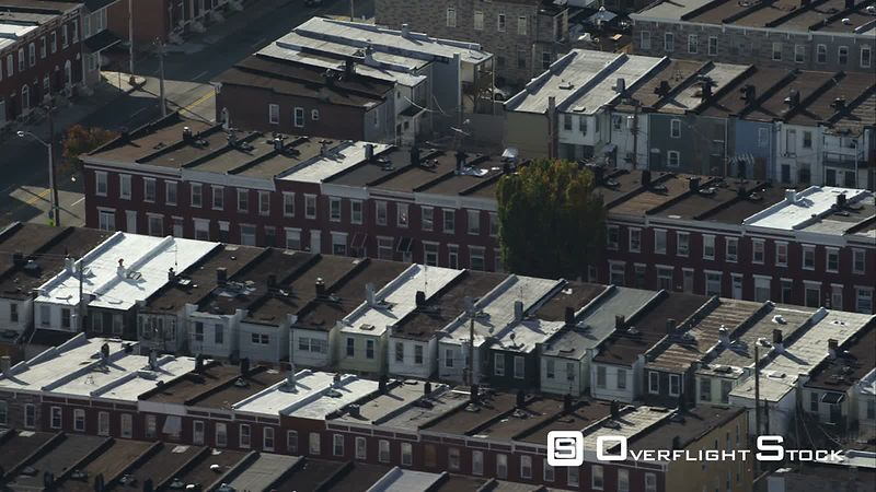 Close orbit over multiple row houses in Baltimore, Maryland. Shot in November