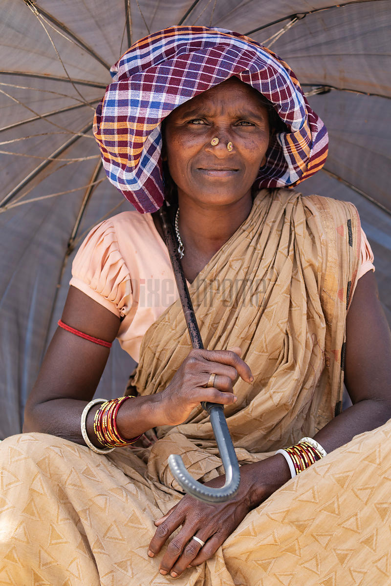 Portrait of a Woman from the Dasia Tribe Shading herself from the Sun under an Umbrella