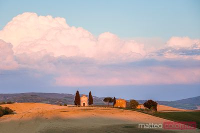 Small church at sunset on the hills of Tuscany, Italy