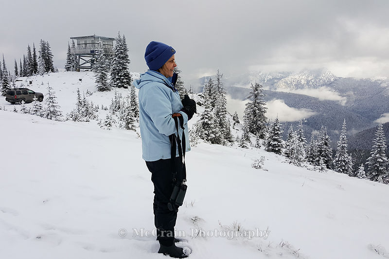 For a mid-day break we drove to the top of Salmo Mountain. Here is Jody taking in the view from 6828 ft up in the snowy mount...