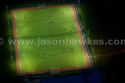 Aerial view of people playing football at night